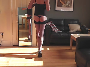 Black corset, fishnet stockings, heels rings and cum