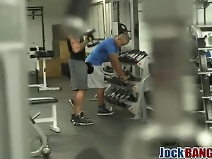 Muscly stud licks ass and sucks schlong in gym